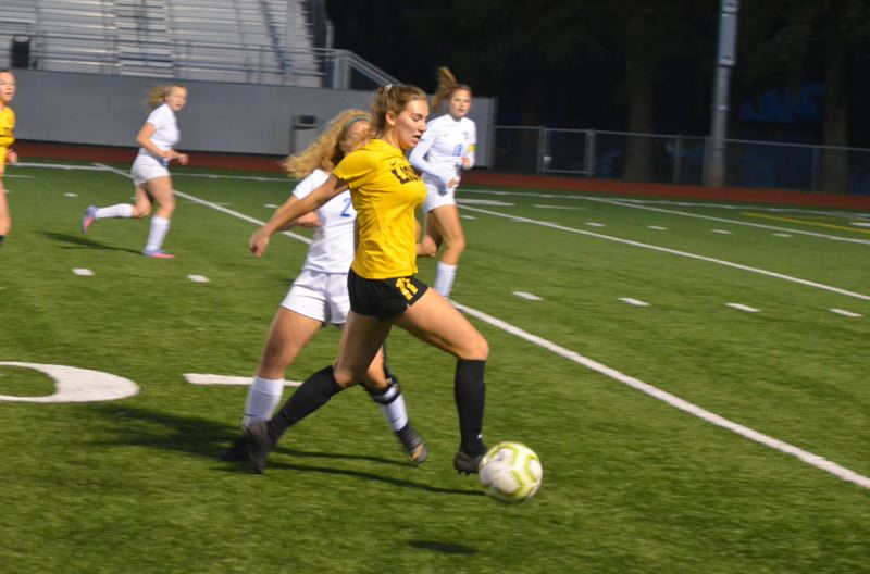 PMG PHOTO: MATT SINGLEDECKER - St. Helens senior Mackenzie Carlson pushes forward with the ball. Carlson earned all-NWOC honorable mention honors for 2019.