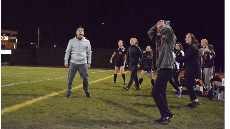 PMG PHOTO: STEVE BRANDON - Scappoose coach Summer Jark (hands on head) and the assistant coaches, including Bruno Zanotta (left), react as the Indians score the winning goal in a 2-1 victory against Putnam.