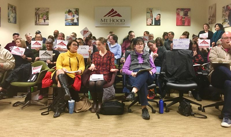 COURTESY PHOTO: CORWIN BENEDICT FROM THE ADVOCATE  - Instructors and staff held signs at the Dec. 4. Mt. Hood Community College Board of Directors meeting to protest the proposed elmination of seven career programs at the college.