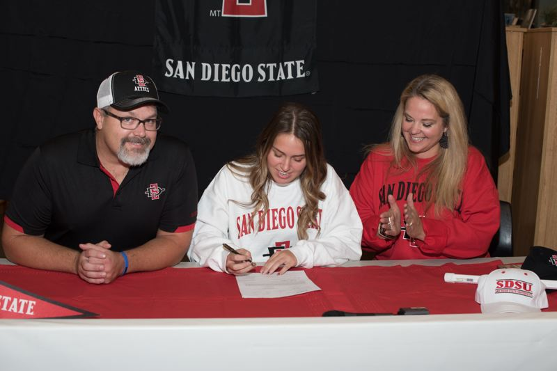 COURTESY PHOTO: GREG ARTMAN - Wilsonville senior Brooklyne Waddell signed with San Diego State during a ceremony at the high school Nov. 14.