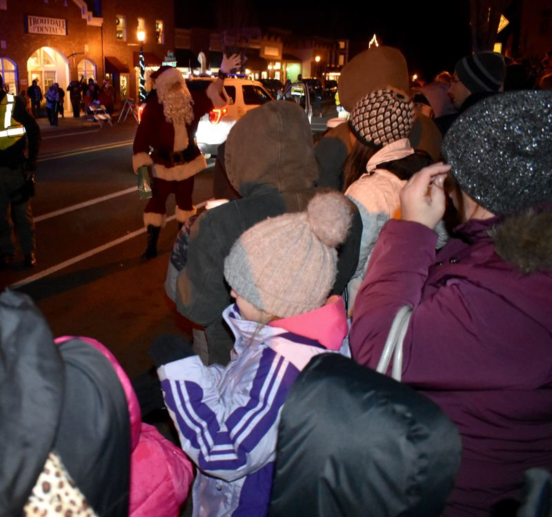 PMG FILE PHOTO - Santa Claus greets the happy crowd at Troutdale's 2018 tree lighting celebration in Mayor's Square on Historic Columbia River Highway.