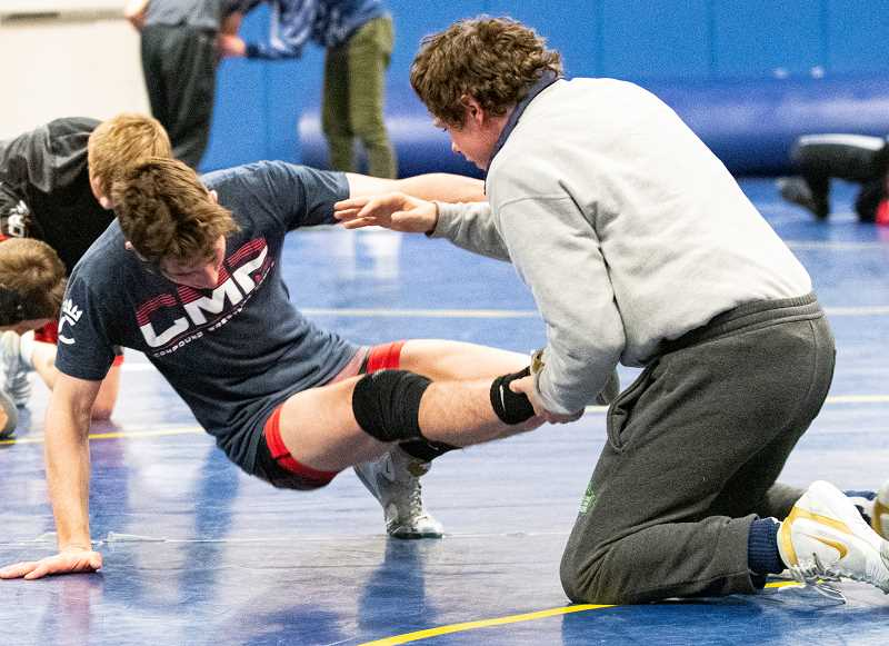 LON AUSTIN/CENTRAL OREGONIAN - Hunter Mode, right, and Trevor Martin work on takedowns during practice on Wednesday. Mode is a defending state champion, while Martin placed at state two years ago, but did not compete at the state tournament last year due to an injury. The Cowboys open their season tomorrow at the Perry Burlison Classic, which will be held at Cascade High School.