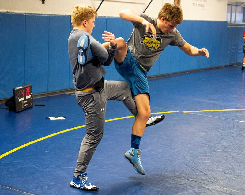 LON AUSTIN/CENTRAL OREGONIAN - Brayden Duke works to take down Ben Sather during a drill at Wednesday's practice. Both Duke and Sather qualified  for last year's state tournament.