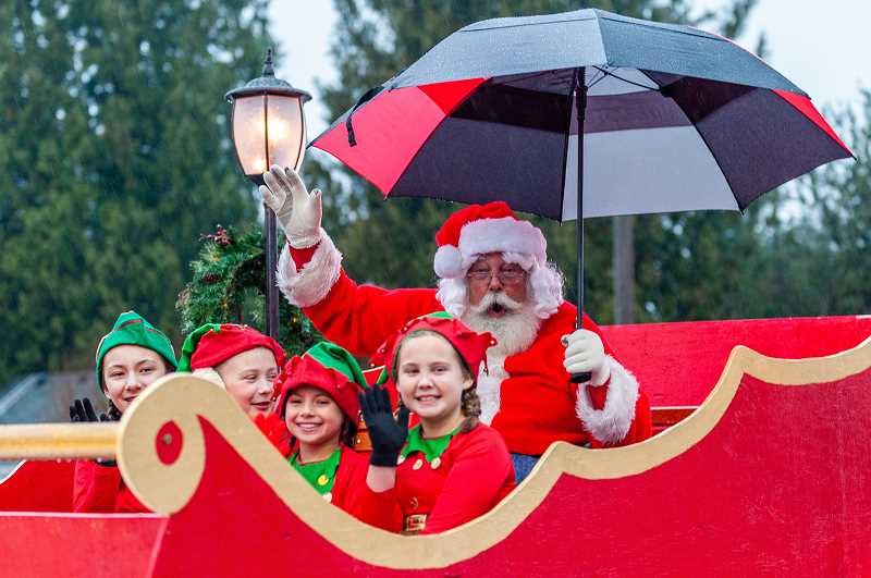 PMG PHOTO: DIEGO DIAZ - Santa and his elves made their way along Sherwood Boulevard into Old Town Sherwood Saturday eveing for the annual tree-lighting ceremony at Cannery Square Park.