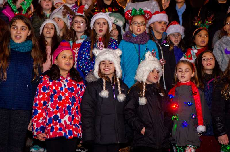 PMG PHOTO: DIEGO DIAZ - Students sing in Cannery Square Park shortly before the annual tree-lighting. The event drew hundreds to Old Town Sherwood.