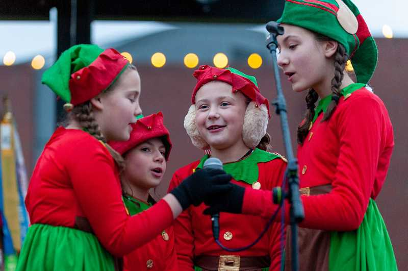 PMG PHOTO: DIEGO DIAZ - Elves sing on stage at Cannery Square Park shortly before the tree-lighting on Dec. 7.