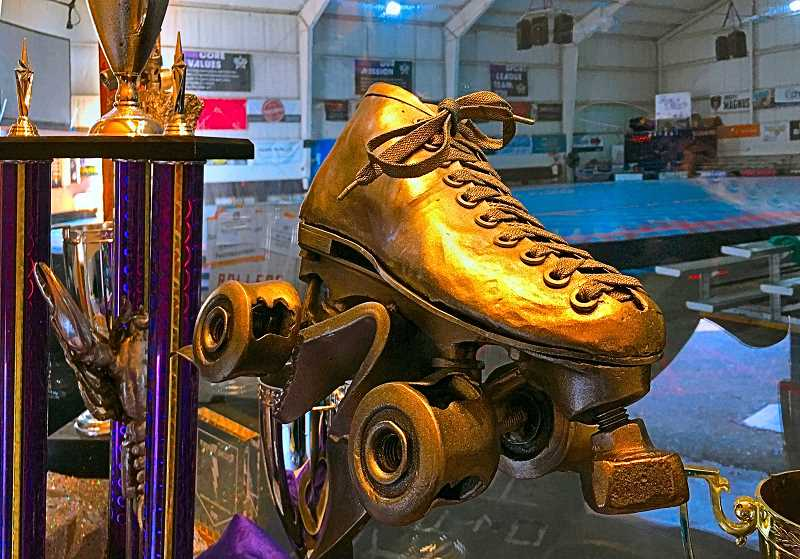 PAIGE WALLACE - Front and center, its The Hydra - the Womens Flat Track Roller Derby Associations World Championship trophy, in the trophy case in The Hangar at Oaks Park. It is designed like a Roller Derby skate, and is named after one of the original founders of WFTDA, who skated under the name Hydra.
