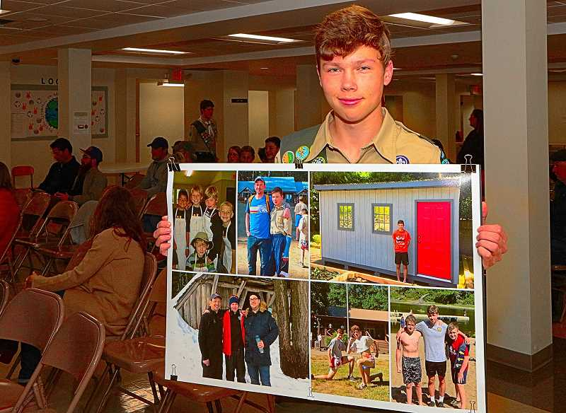 DAVID F. ASHTON - Inner Southeast Portlands newest Eagle Scout, Aidan Burns, shows a collage of photos of himself enjoying experiences during his life with Boy Scout Troop 64.