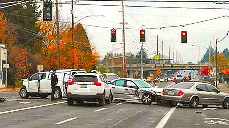 DAVID F. ASHTON - The intersection of S.E. 92nd Avenue at Division Street in the Lents neighborhood was closed for hours, after a multiple-vehicle smashup caused by a red-light-runner.