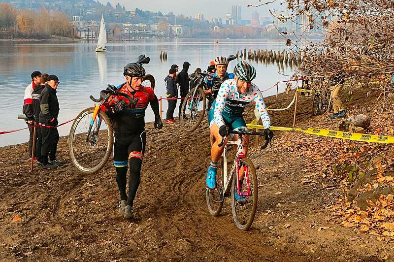 DAVID F. ASHTON - Some carry their bikes, while others ride along the Willamette River beachfront, in the inaugural BCCX Cyclocross at Oaks Amusement Park.