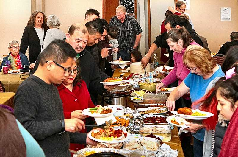 DAVID F. ASHTON - Members of the several congregations who meet at the Bethel Assembly of God Church in the Brentwood-Darlington neighborhood gathered for a truly multicultural Thanksgiving dinner.
