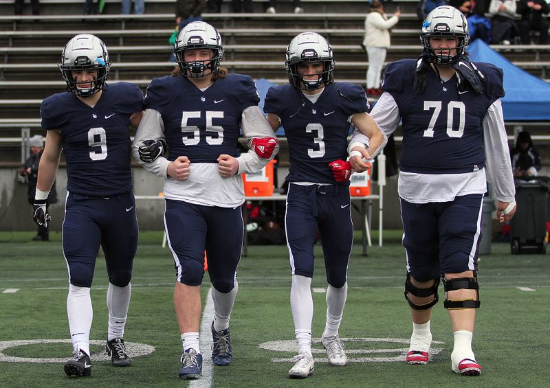 PMG PHOTO: MILES VANCE - Lake Oswego senior captains (from left) Casey Filkins, Cody Carlson, Joe Hutson and Tiger Shanks left a legacy of success at LO, going 35-5 overall the past three seasons.