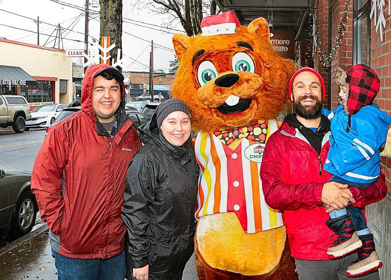 DAVID F. ASHTON - On S.E. Bybee Boulevard, flanking Chipper - the mascot who came up from historic Oaks Amusement Park to be part of Decemberville - were Davey and Sarah Billings; and Ben Jackson, holding Connor.