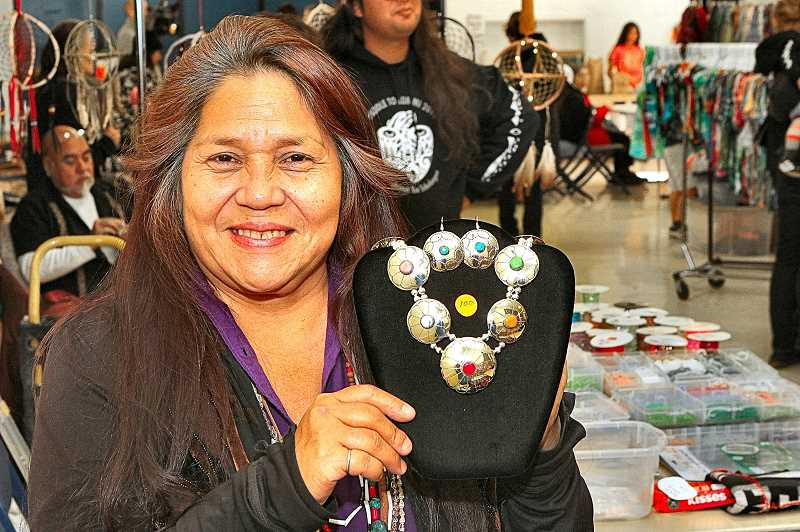DAVID F. ASHTON - A member of the Yurok tribe, Pamela Brooks, shows a necklace - from RRB Native Jewelry.