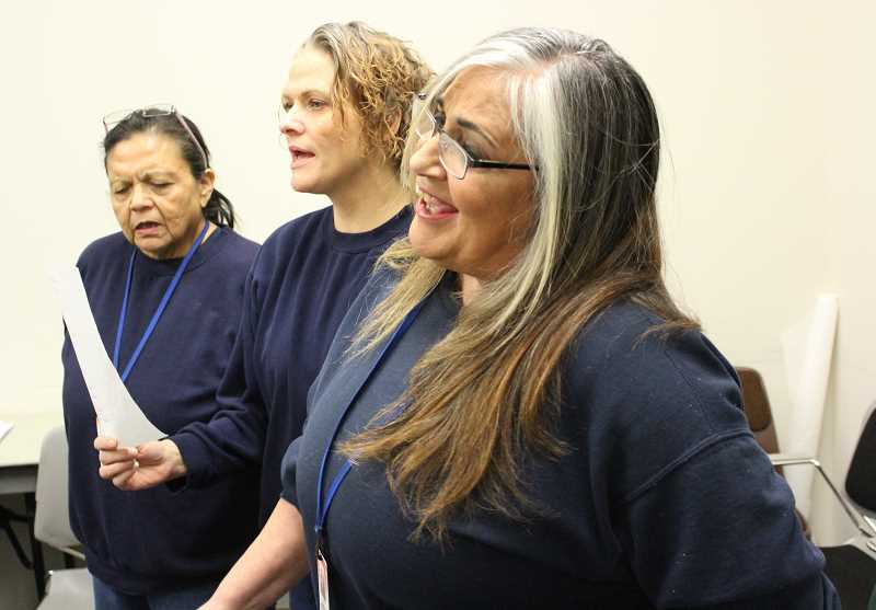 PMG PHOTO: COREY BUCHANAN - From right: Catherine Garlstaun, April Anderson and Vanessa Smith sing in preparion for a performance with the Oregon Symphony.
