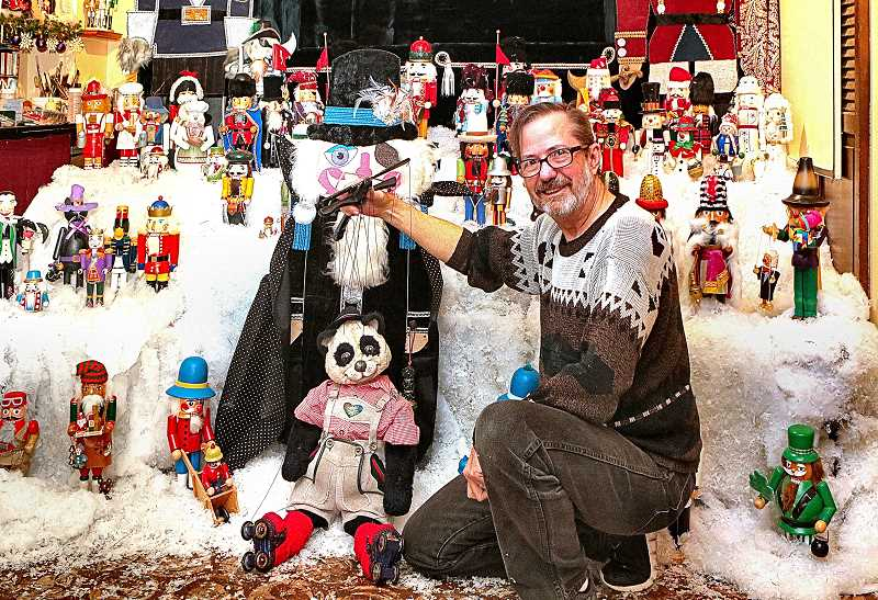 DAVID F. ASHTON - Finishing the installation of the Nuts about Nutcrackers display for Christmas, its Portland Puppet Museums Steve Overton.