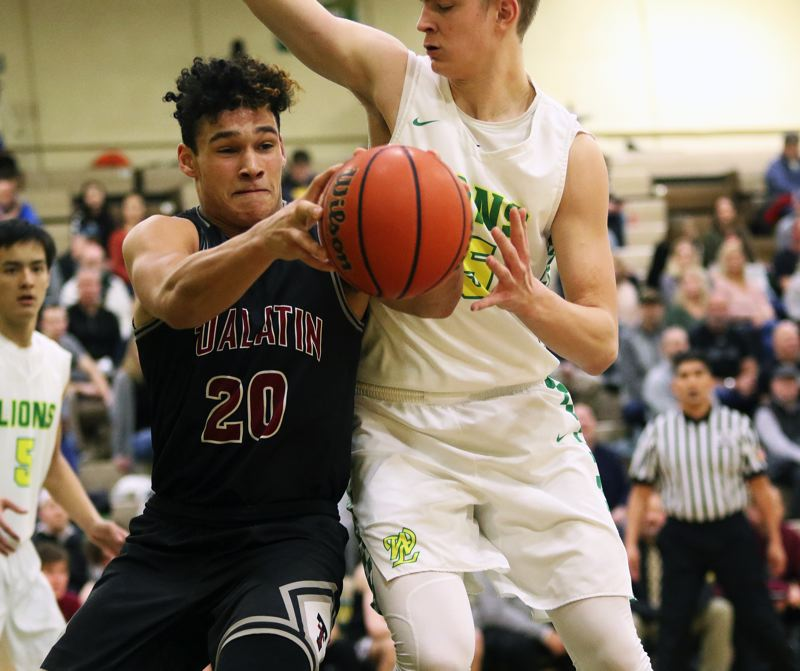 PMG FILE PHOTO: DAN BROOD - Tualatin High School senior John Miller (left) was named the Three Rivers League Defensive Player of the Year last year as a junior.