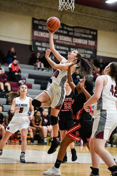 PMG PHOTO: CHRISTOPHER OERTELL - Glencoe's Bella Martinez goes up for a lay-in during the Tide's game against David Douglas Thursday, Dec. 5, at Glencoe High School.