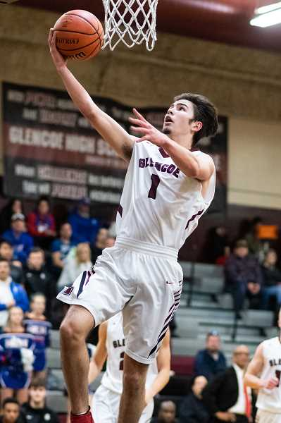 PMG PHOTO: CHRISTOPHER OERTELL - Glencoe's Grayson Landon goes to the basket during a Tide game last season.