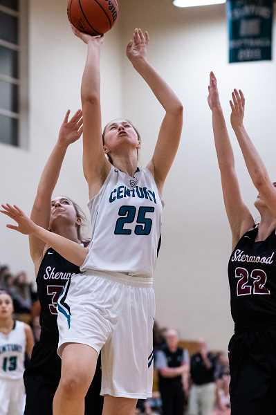 PMG PHOTO: CHRISTOPHER OERTELL - Century's Amy Walkenhorst during a Jaguars game last season. The 6-foot-6 post will be a key contributor for Century this season.