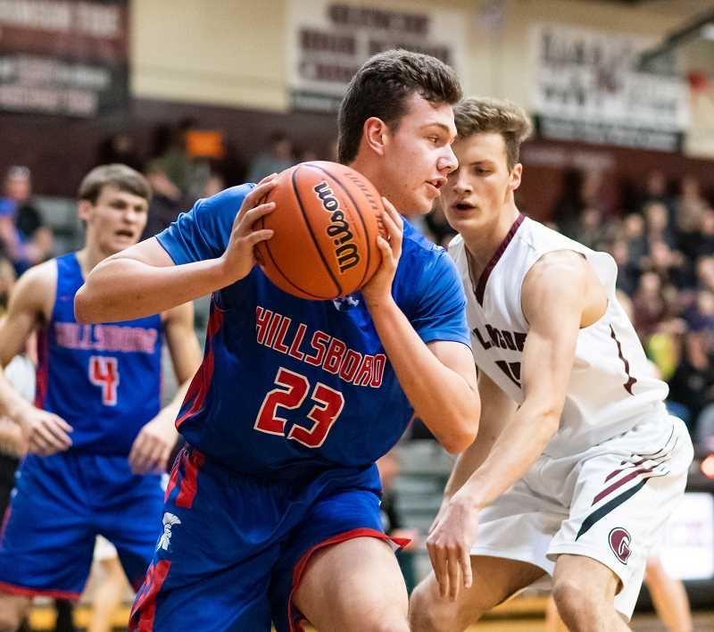 PMG PHOTO: CHRISTOPHER OERTELL - Hillsboro's Nate Smith does work on the block during a Spartans game last season. Smith will be a key contributor to Hilhi's success this year.