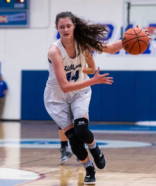 PMG PHOTO: CHRISTOPHER OERTELL - Hillsboro's Rian Porter attacks the defense during a Spartans game last season. Porter is one of five returning starters for the Hilhi girls.