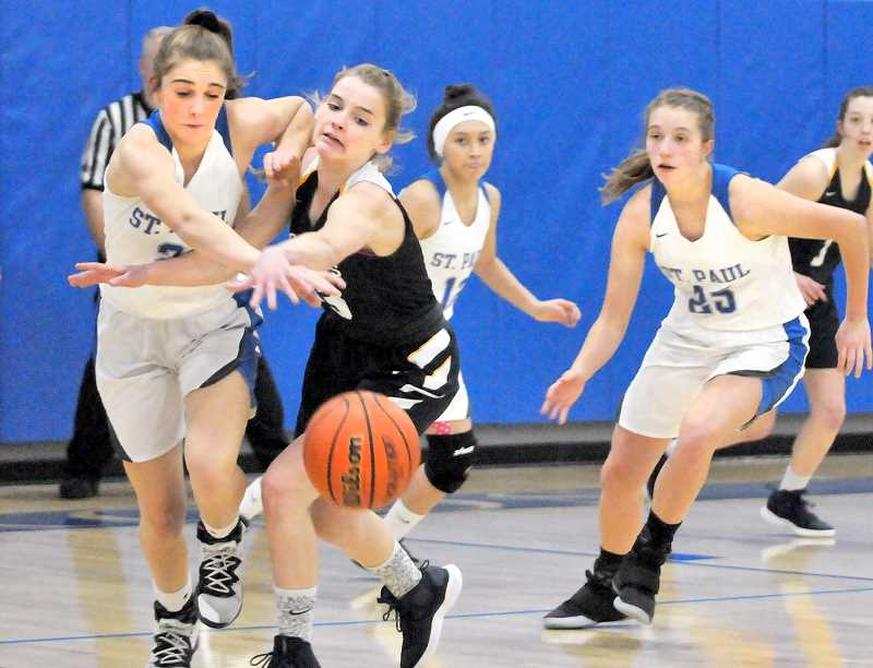 GRAPHIC PHOTO: GARY ALLEN - The St. Paul girls basketball team's stifling defense has become its signature, consistently holding opponents to low point totals and forcing turnovers.