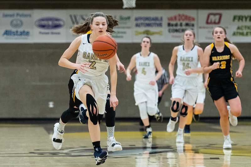 PMG PHOTO: CHRISTOPHER OERTELL - Banks High School's Maggie Streblow (2) during an OSAA girls basketball game against Philomath High School at Forest Grove High School in Forest Grove, Ore., on Thursday, March 7, 2019.