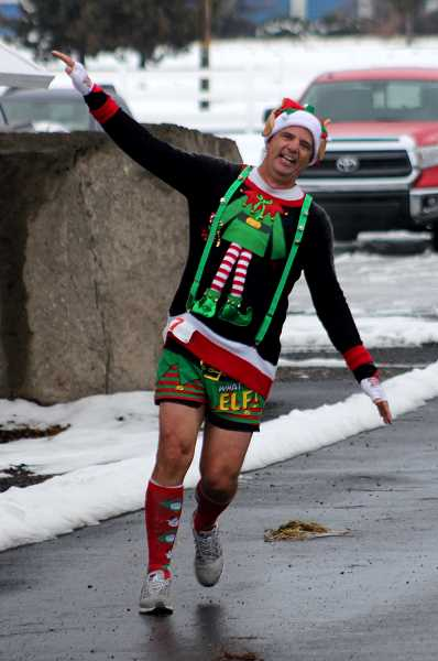 STEELE HAUGEN - Canyon Rumble Frozen Half-marathon participants show their holiday spirit as they celebrate after crossing the finish line Dec. 7.