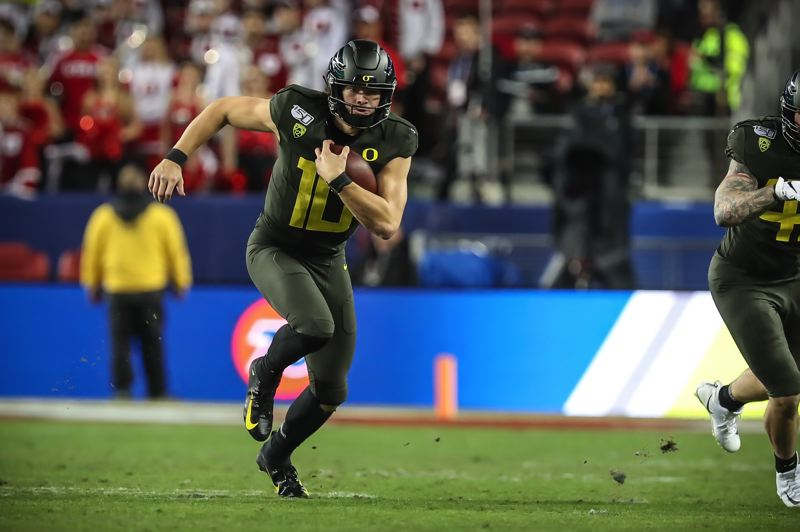 COURTESY PHOTO: SERENA MORONES - Justin Herbert and the Ducks saw their path to the College Football Playoff blocked by narrow loss to Auburn and Arizona State