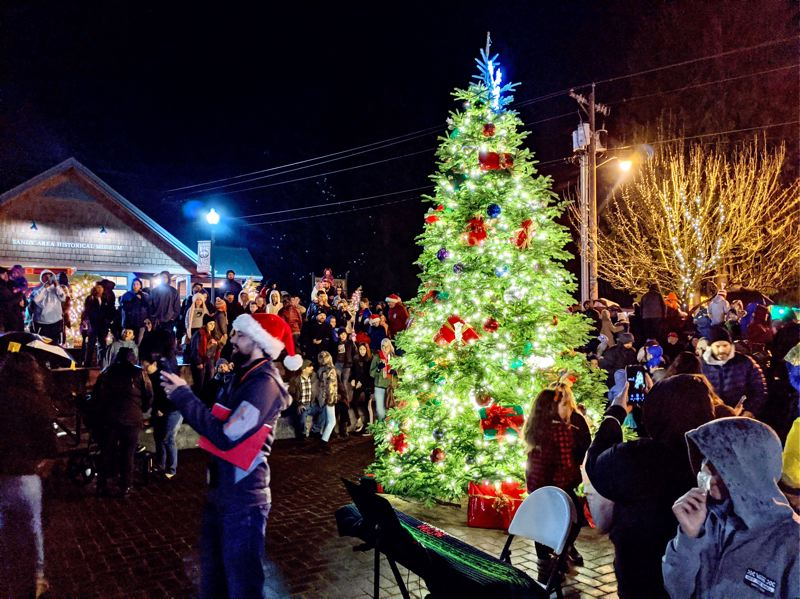 PMG PHOTO: BRITTANY ALLEN  - The Christmas season was kicked off in Sandy with the annual tree lighting ceremony on Dec. 6.