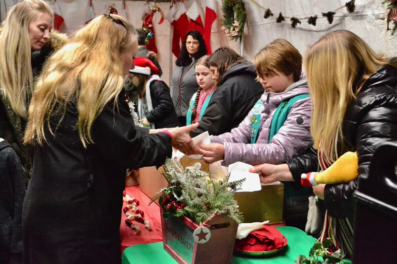 PMG PHOTO: BRITTANY ALLEN  - Scouts helped served refreshments at the annual tree lighting event on Friday.