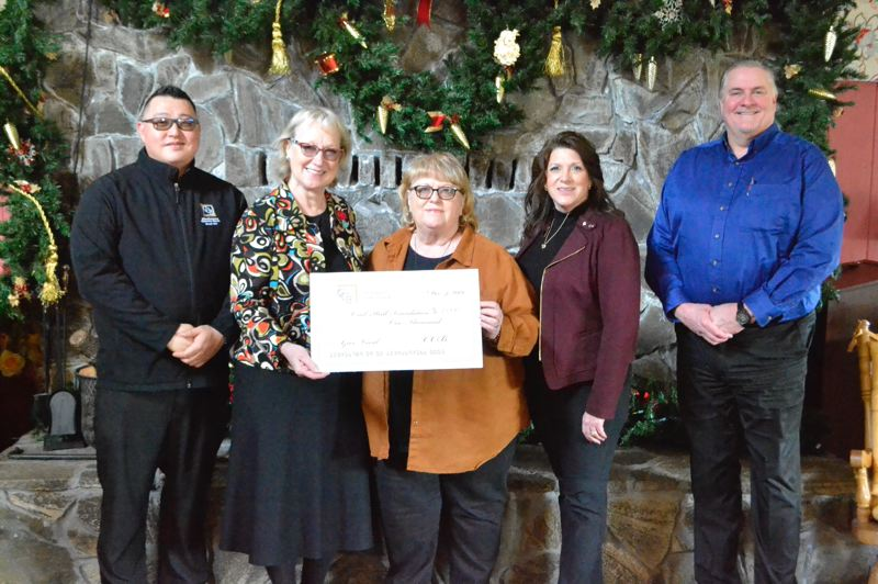 PMG PHOTO: BRITTANY ALLEN - Brian York and Cathy Stuchlik of Clackamas County Bank present Sharon Elder of the Oral Hull Foundation with a check from Pamplin Media Groups Give Local program with the help of Pamplin advertising staff Alisa Applegate and Rich Nobes.