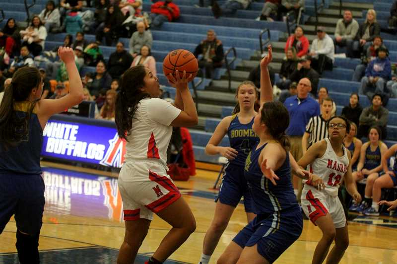 STEELE HAUGEN - Jiana Smith-Francis scores 25 points in three quarters during the Lady Buffs' 71-27 victory over Toledo Dec. 6.  Madras starts the season 1-2 and will travel to Bend High to take on the Lava Bears Dec. 17.