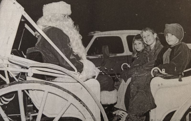 PMG FILE PHOTO - The Christmas season was in full swing in Sandy at this time 20 years ago. The Post featured photos of residents parading through town with Santa Claus himself.