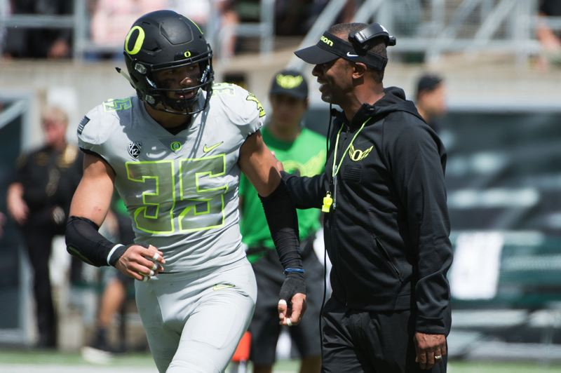 PMG PHOTO: CHRISTOPHER OERTELL - Troy Dye and his classmates had three head coaches in four seasons at Oregon, including Willie Taggart as a sophomore in 2017.