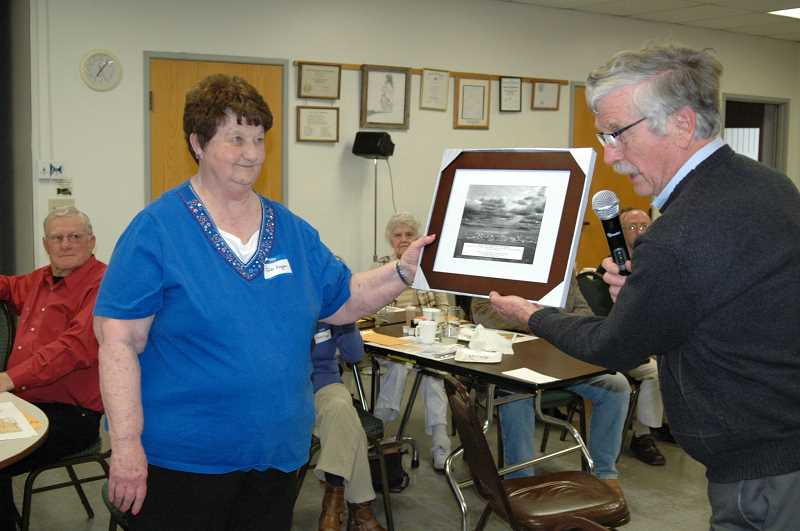 SUSAN MATHENY/MADRAS PIONEER - Jodi Eagan was presented with the Beth Crow Award by historical society president Jerry Ramsey in April 2014.