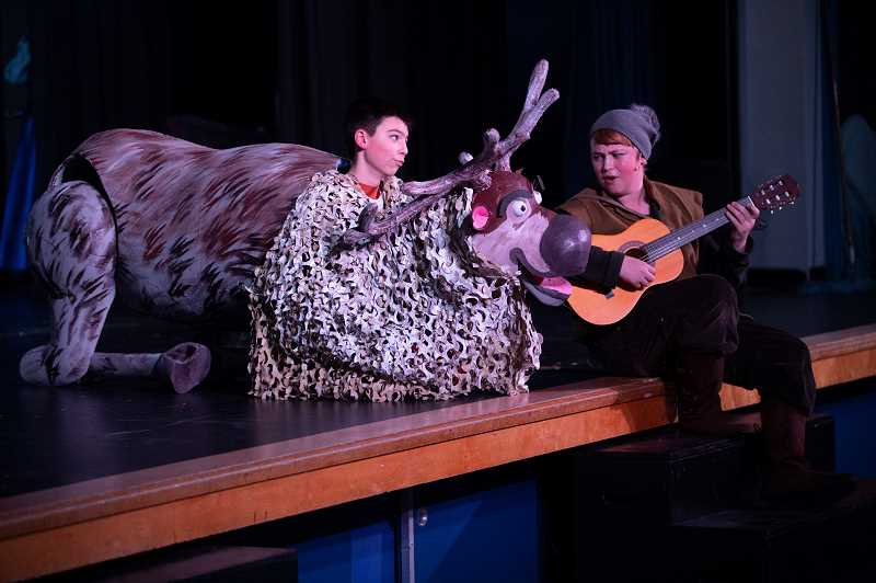 PMG PHOTO: JONATHAN HOUSE - Tate O'Hallaren plays Sven the reindeer, left, and Brody Amberg plays Kristoff in the Lakeridge production of Frozen JR.