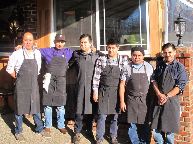 PMG PHOTO: BILL GALLAGHER - The Garnica brothers all worked at the Verde Cocina location on Sylvan on Thanksgiving Day. Left to right: Noe Garnica (co-owner and head chef), Mariano Zamora (volunteer), brothers: Abdon Garnica, Diego Garnica, Miguel Garnica and Lupe Garnica