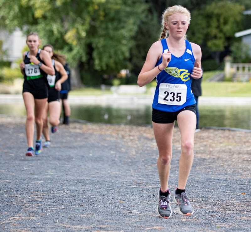 LON AUSTIN/CENTRAL OREGONIAN - Savannah Jessee leads a group of runners at the Oxford Classic. Jessee finished sixth at the Intermountain Conference championships, just missing a trip to state.