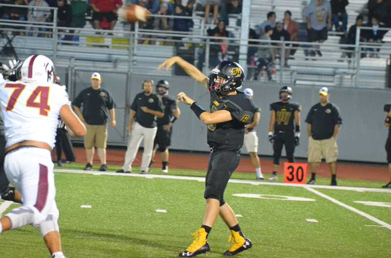 COURTESY PHOTO: JOHN BREWINGTON - St. Helens High quarterback Jakob Robbins delivers a pass.