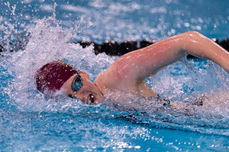 PMG PHOTO: CHRISTOPHER OERTELL - Forest Grove's Luci Brenner competes during the Vikings' dual meet with Glencoe Thursday, Dec. 12, at the Forest Grove Aquatic Center in Forest Grove.
