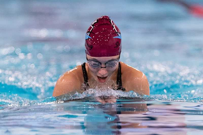 PMG PHOTO: CHRISTOPHER OERTELL - Glencoe's Emma Dreher competes in the breaststroke event during the Crimson Tide's dual meet with Forest Grove Thursday, Dec. 12, at the Forest Grove Aquatic Center in Forest Grove.