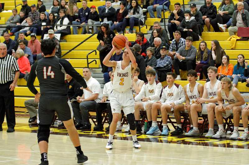 PMG PHOTO: WADE EVANSON - Forest Grove's Ryan Kribs preps a shot attempt during the Vikings' game against David Douglas Friday night, Dec. 13, at Forest Grove High School.