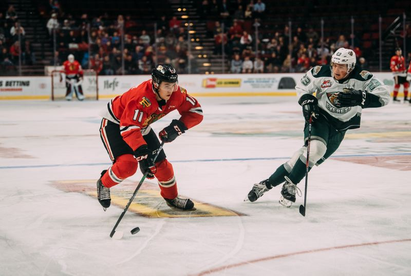 COURTESY PHOTO/KENDRA FRANKLE/PORTLAND WINTERHAWKS - Robbie Fromm-Delorme skates around Everett's Jake Christiansen during the Winterawks 3-2 Friday win over the Silvertips. Fromm-Delorme scored his fourth goal of the season in the game.