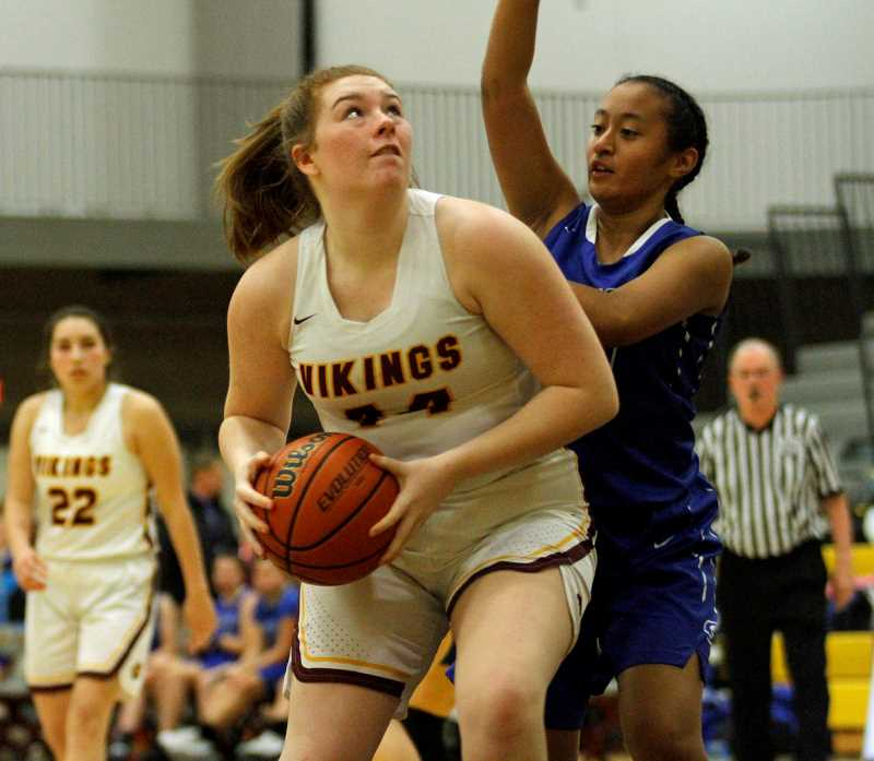 PMG PHOTO: WADE EVANSON - Forets Grove's Olivia Grosse plays from the post during the Vikings' game againt Gresham Friday night, Dec. 13, at Forest Grove High School.