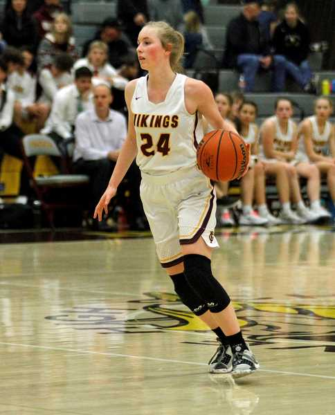 PMG PHOTO: WADE EVANSON - Forest Grove's Ashlynn Dawson dribbles the ball up the floor during the Vikings' game againt Gresham Friday night, Dec. 13, at Forest Grove High School.