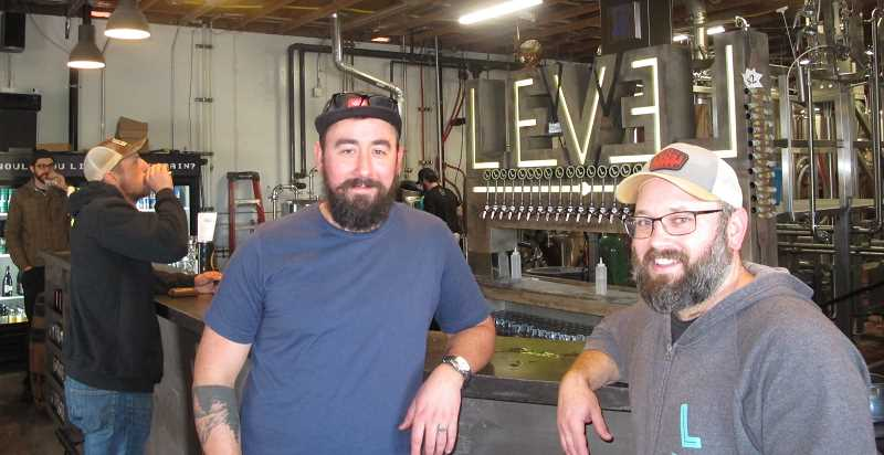 PMG PHOTOS: BILL GALLAGHER - Jason Barbee (l) and Shane Watterson (r), two of the three founders of Level Brewing, at their tap room in Norhteast Portland.