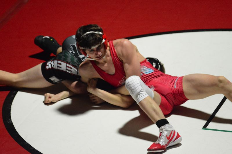 PMG PHOTO: DAVID BALL - Centennials Jake Angelovic closes in on a pin during his win at 120 pounds.
