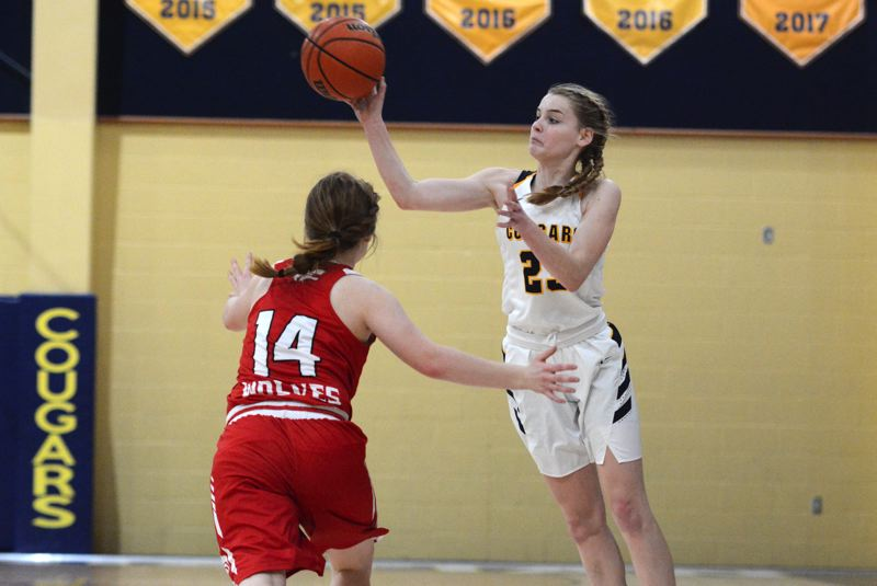 PMG PHOTO: DEREK WILEY - Country Christian sophomore Lizzy Grandle had six assists along with six rebounds and 23 points Saturday against Days Creek.